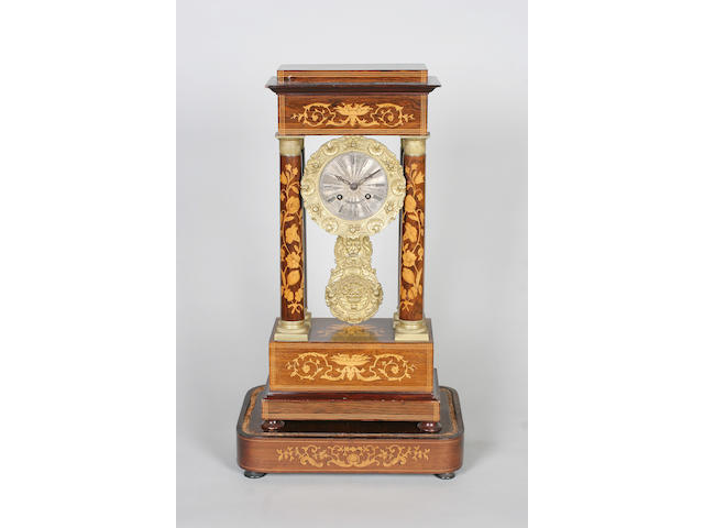 A mid-19th century Dutch rosewood and marquetry portico clock