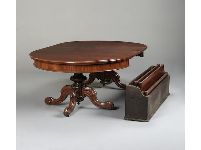 A Victorian mahogany twin pillar extending dining table