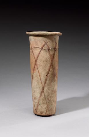 An Egyptian Pre-Dynastic 'wavy-handled' cylindrical pottery jar