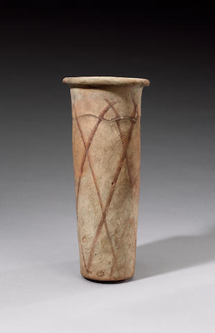 An Egyptian Pre-Dynastic 'wavy-handled' cylindrical pottery jar