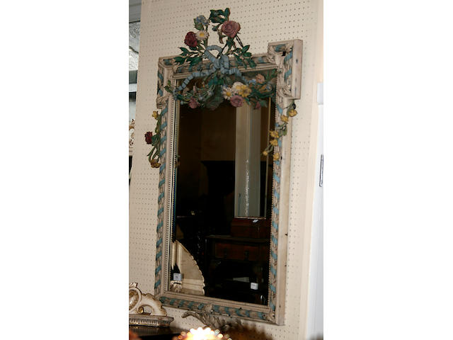 A bevelled wall mirror,