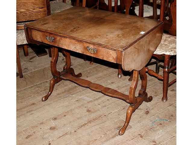 A reproduction walnut veneered sofa table,