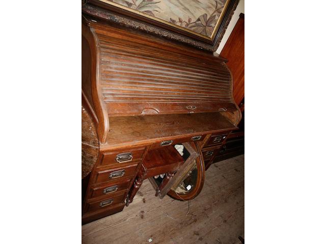A circa 1920s or 1930s oak roll top desk