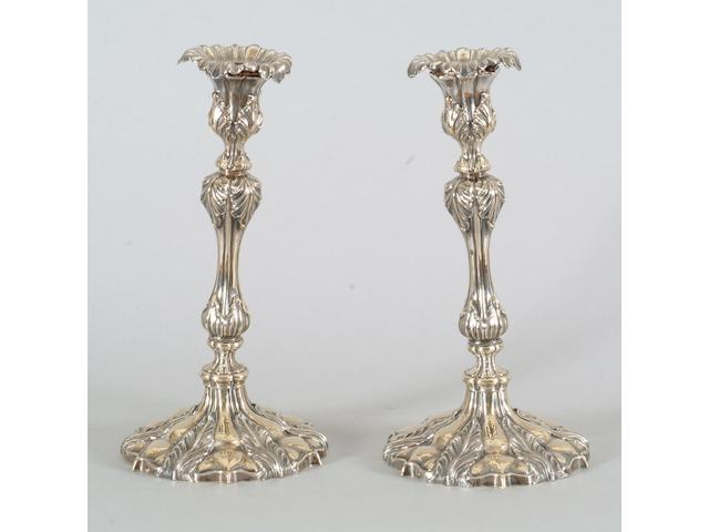A pair of late Victorian candlesticks unmarked,