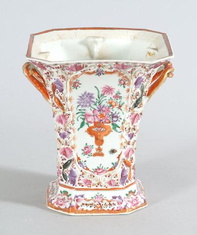A cantonese bough pot and a pair of Japanese imari vases.