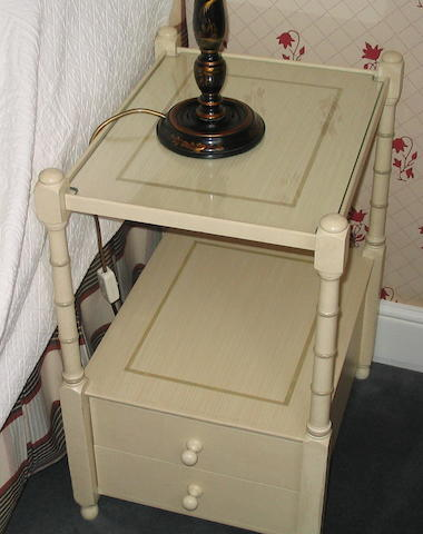 A pair of painted bed side table
