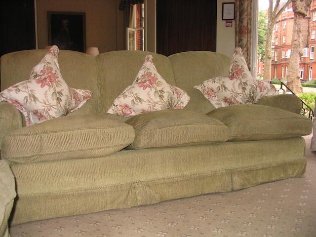 A pair of green upholstered three seater sofas