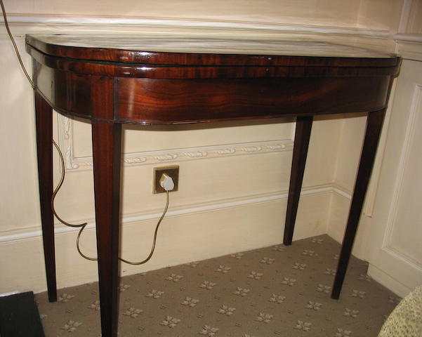 A George III mahogany D-shaped card table