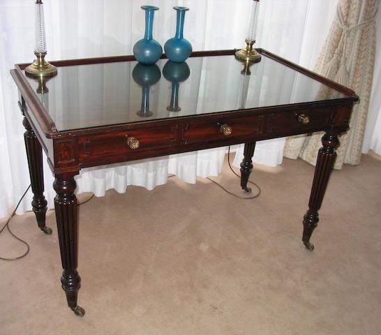 An early 19th century mahogany side table