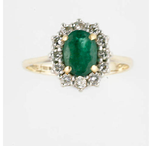 An oval emerald and diamond cluster ring,