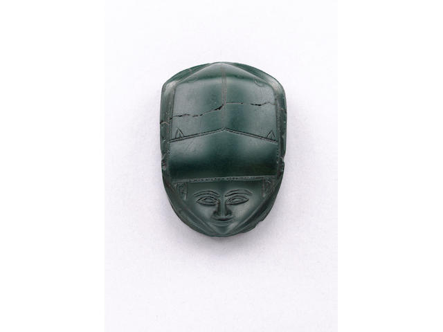 An early Egyptian human-headed green jasper heart scarab