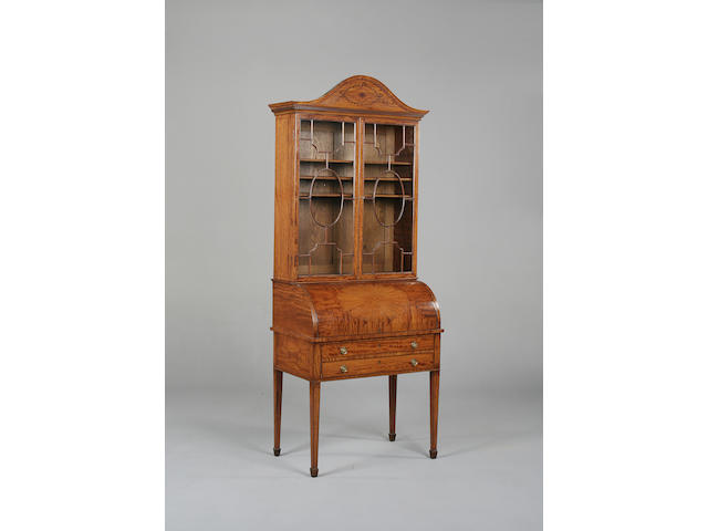 An Edwardian satinwood cylinder bureau bookcase
