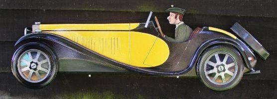 A hand painted wooden profile of a Bugatti Type 55,
