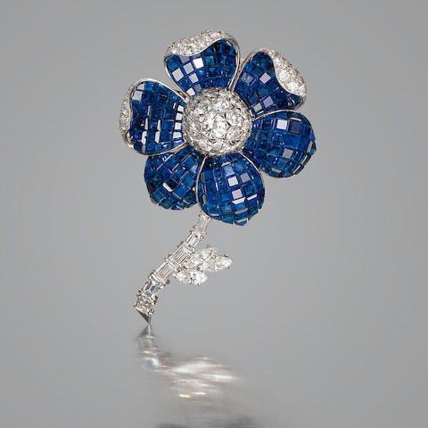 A fine diamond and sapphire floral brooch,