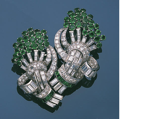 An emerald and diamond double clip brooch,
