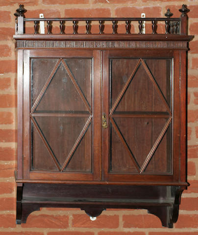 A pair of late 19th century American walnut hanging cabinets,