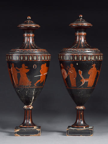 A pair of George III carved and decorated urns in the Etruscan taste