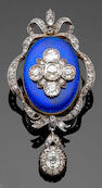 A Victorian blue enamel and diamond pendant / brooch in fitted case