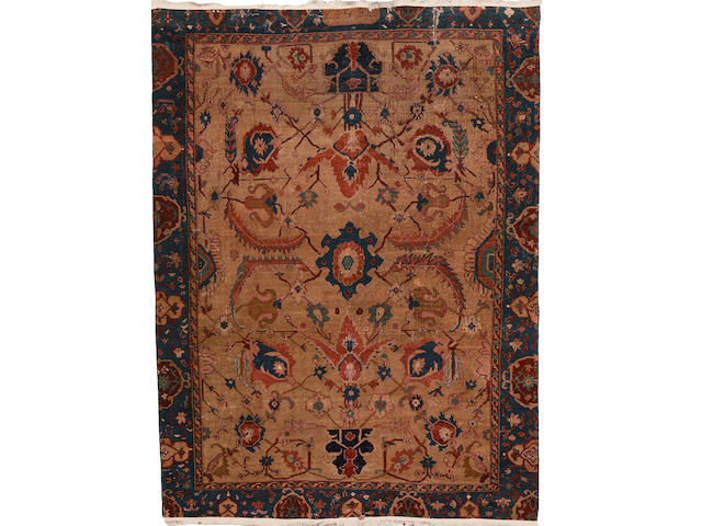 A Rare late 18th century West Persian carpet 8 ft 3 in x 6 ft 2 in (252 x 187 cm) lacking part of border, rug is in a very fragile state