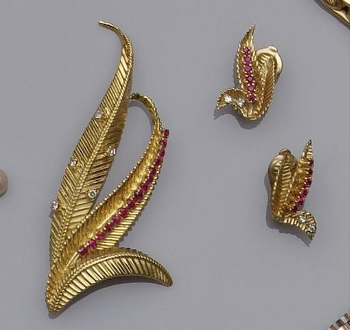 An 18ct gold, ruby and diamond leaf spray brooch