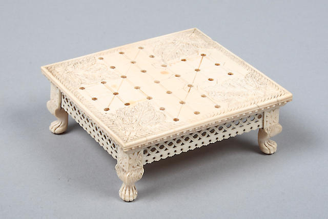 A late 19th Century carved ivory games board