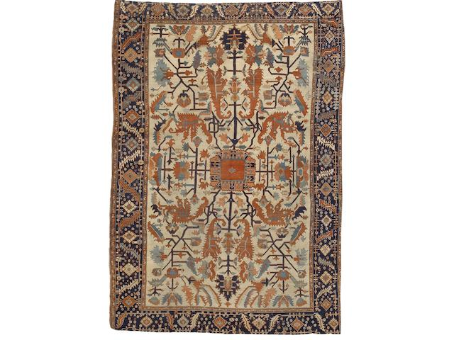 A Serapi carpet North West Persia, 13 ft 11 in x 9 ft 7 in (427 x 291 cm) lacking outer guardstripe at each end