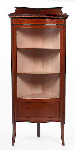 An Edwardian mahogany corner display cabinet