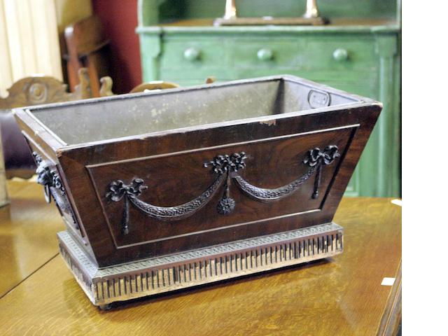 A late 19th century mahogany log box, in the neo-classical style