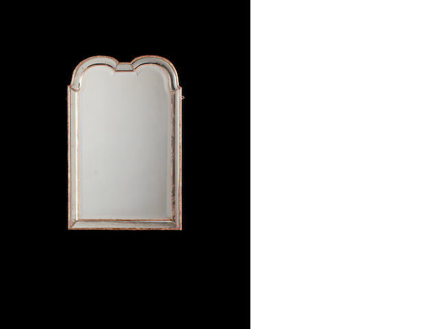 A George I double-domed wall mirror the shaped rectangular bevelled plate within a faceted mirrored