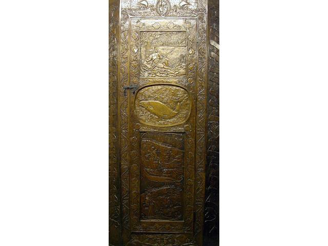 A late 19th Century carved oak corner cupboard