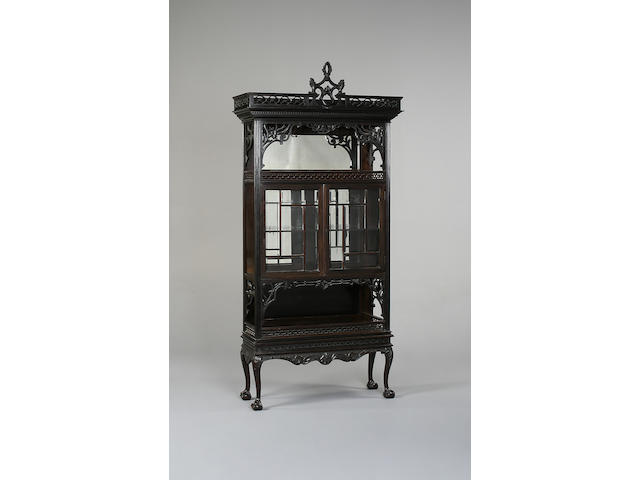 A late 19th Century ebonised display cabinet,