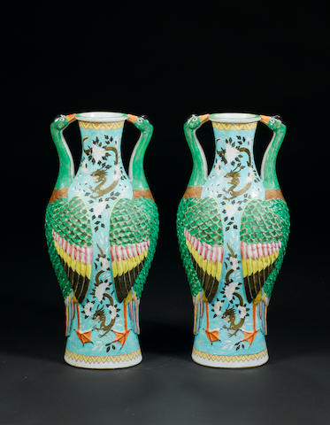 A pair of famille rose crane vases (one handle restored)