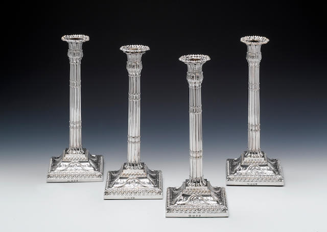 A set four George III silver corinthian column candlesticks, by John Carter (II), London 1770,