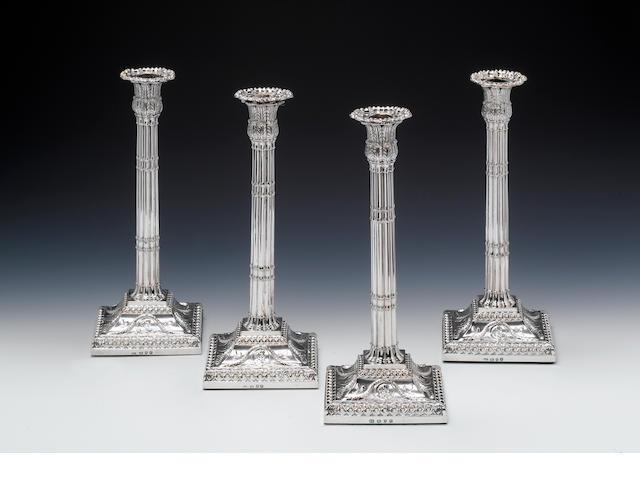 A set four George III silver corinthian column candlesticks, by John Carter (II), London 1770,