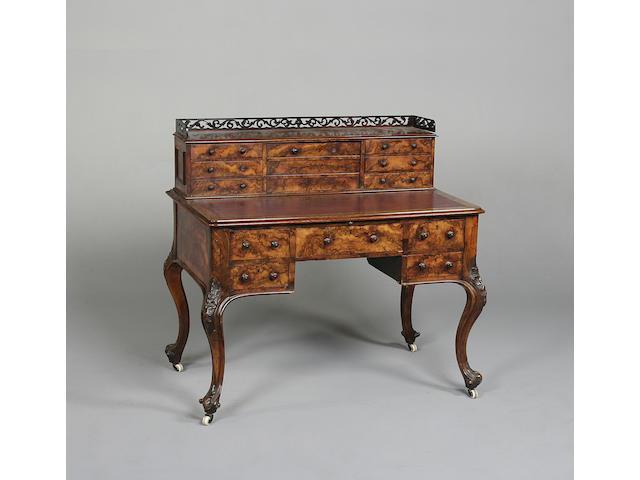 A 19th century burr walnut writing desk