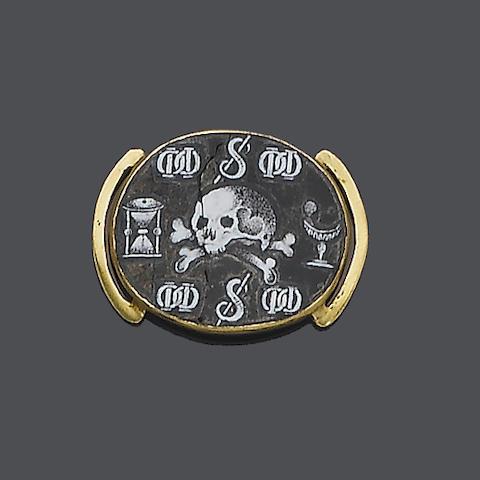 An mid 17th century enamel 'memento mori' slide,