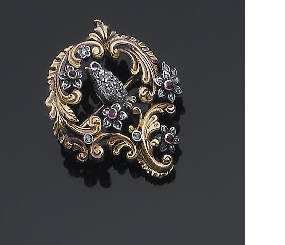 A diamond, ruby and sapphire bird brooch,