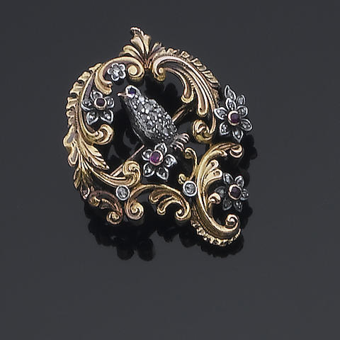 A diamond, ruby and sapphire bird brooch,