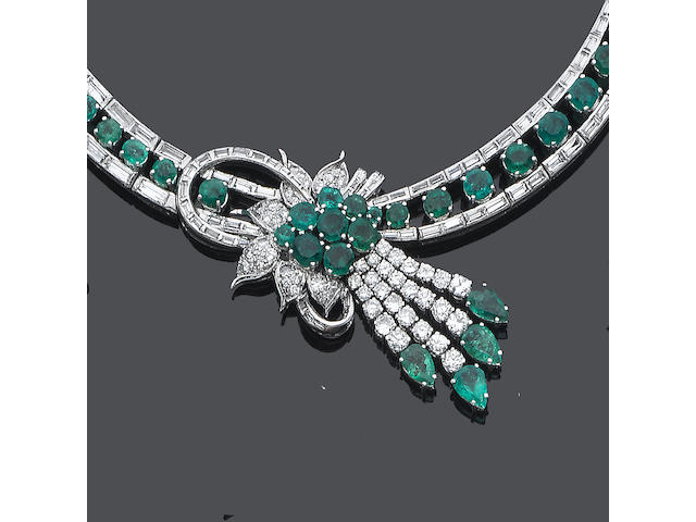 An emerald and diamond necklace, bracelet, earring and ring suite