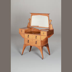 An Art and Crafts oak dressing table by Maple and Co