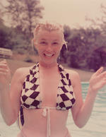 Milton H Greene (American, 1922-1985) Marilyn Monroe, wearing a checquered towelling bikini top, wet from the pool, c-type print, stamped `Milton H Greene, Edward Weston Collection`also stamped Milton H Green Trust 1992 verso, also numbered 9/99, 35.6 x 27.8cm(14 x 11in) together Marilyn in Seven Year Itch by Sam Shaw and an unidentified image of Marilyn waving from an American Airlines plane, various, all unframed (3)