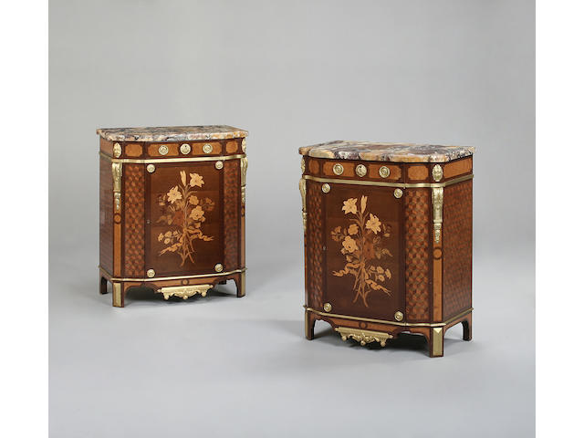 A pair of early 20th century purple wood, mahogany, amboyna, gilt metal mounted and marquetry commodes stamped Francois Linke,