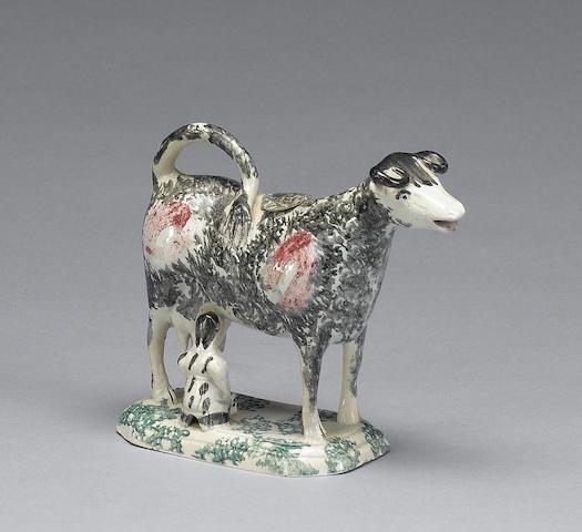 A pearlware cow creamer and cover, circa 1800