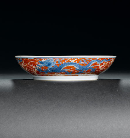 An underglaze-blue and iron-red 'dragon' dish Kangxi six-character mark and of the period