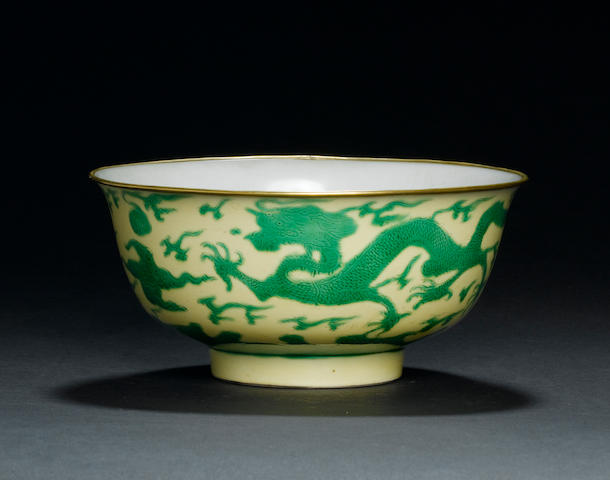 A green and yellow 'dragon' bowl Kangxi six-character mark and of the period