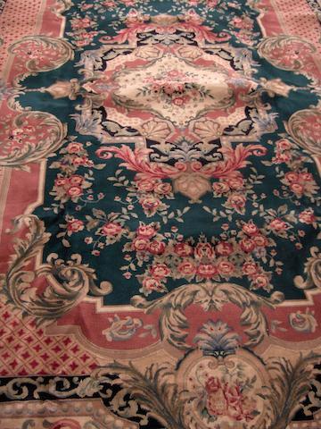 A Savonnerie design carpet 380cm x 281cm