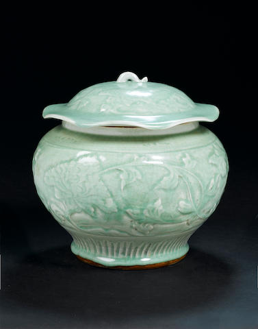 A carved celadon globular jar and cover, guan Ming Dynasty