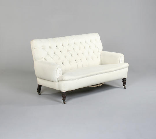 A late Victorian mahogany sofa