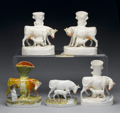 A pair of cow and calf spill vases, and two others similar, 19th century
