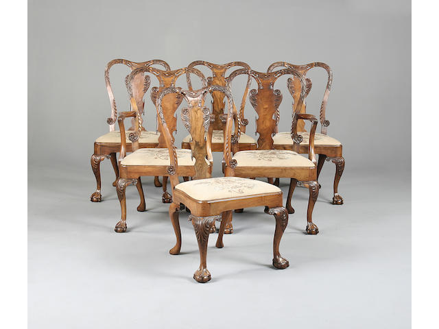 A set of six Queen Anne style walnut dining chairs